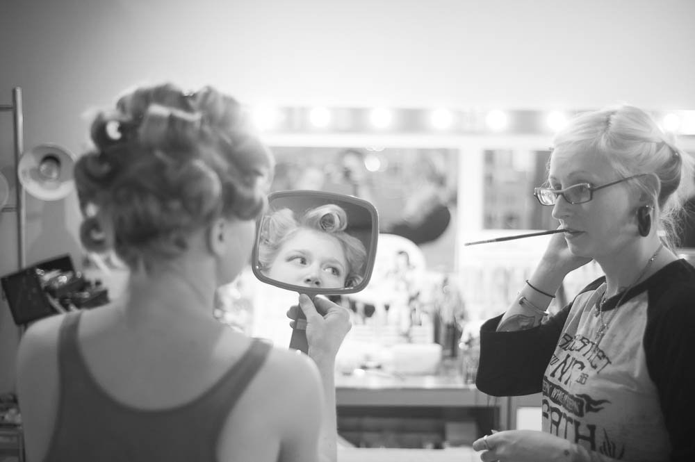 bride discusses makeup with her artist during getting ready at cara dulce makeup in houston texas