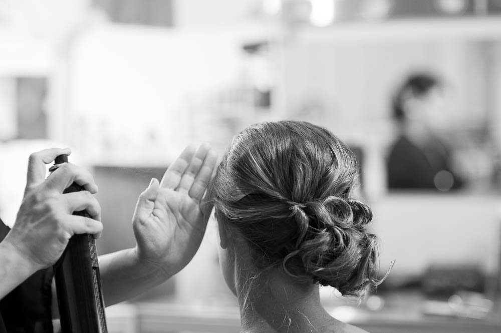 bridesmaid getting her hair sprayed before the wedding during the getting ready process, cara dulce makeup houston,