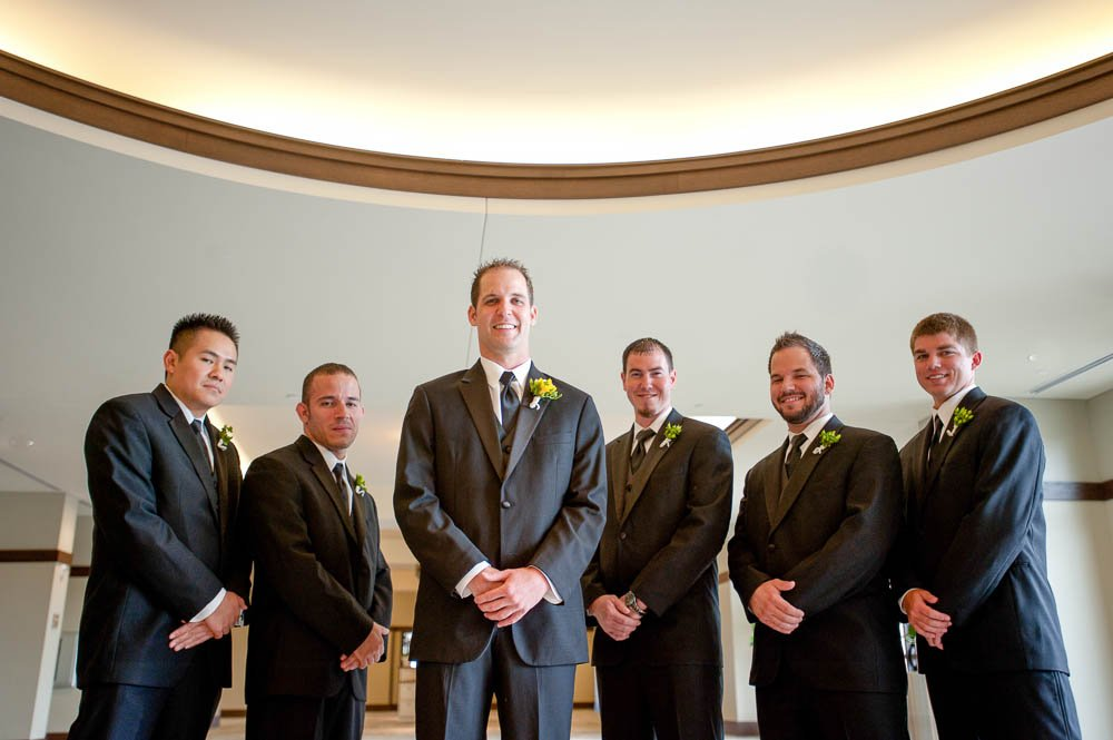 group shot of groomsmen and groom looking tough