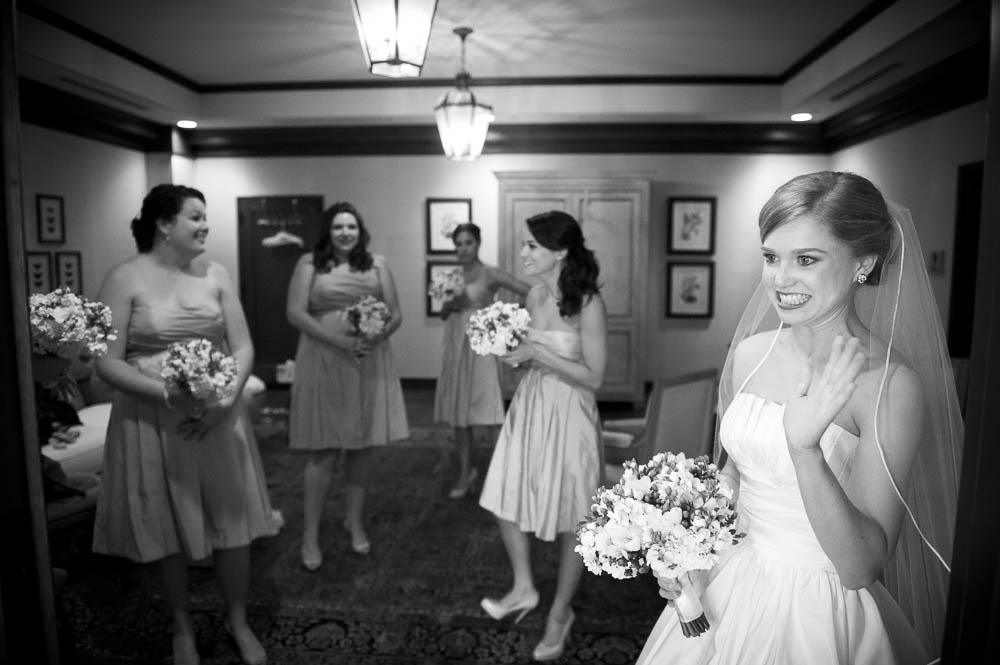 bride waving to guests