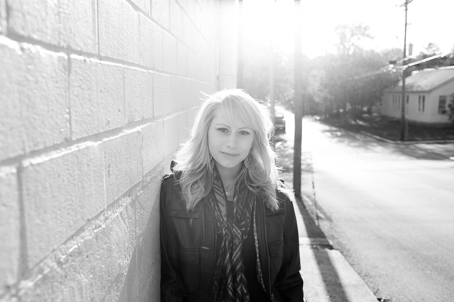 black and white girl smiling at camera, graduation portraits of blonde girl, texas state senior photographs, girl portriats