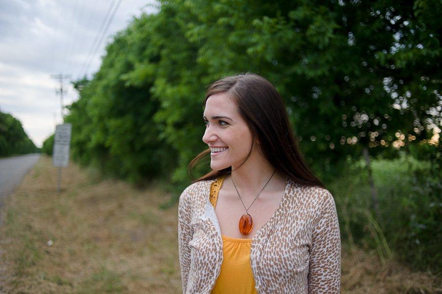 girl smiling naturally graduation portraits austin texas