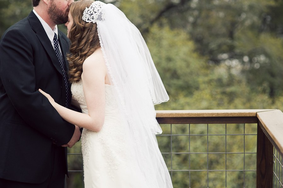 luther hill wedding, forehead kiss bride and groom,