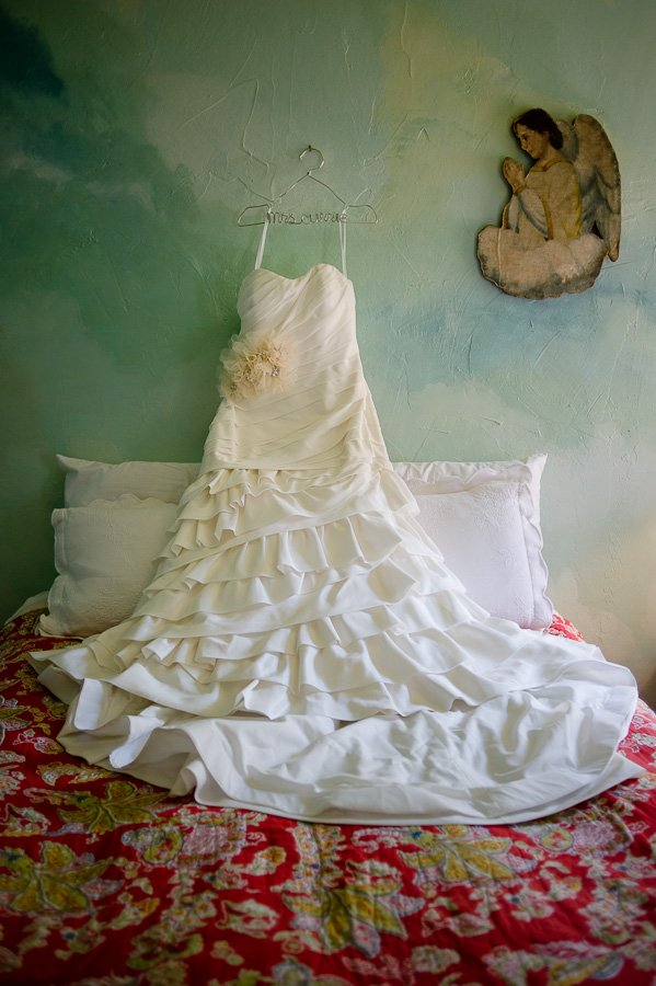 wedding dress hanging shot, vintage ranch austin wedding, rustic chic dress hanging