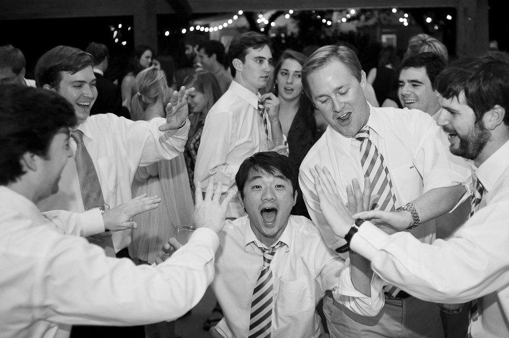 crazy groomsmen at wedding reception, artistic wedding photographer, fun and playful wedding austin texas