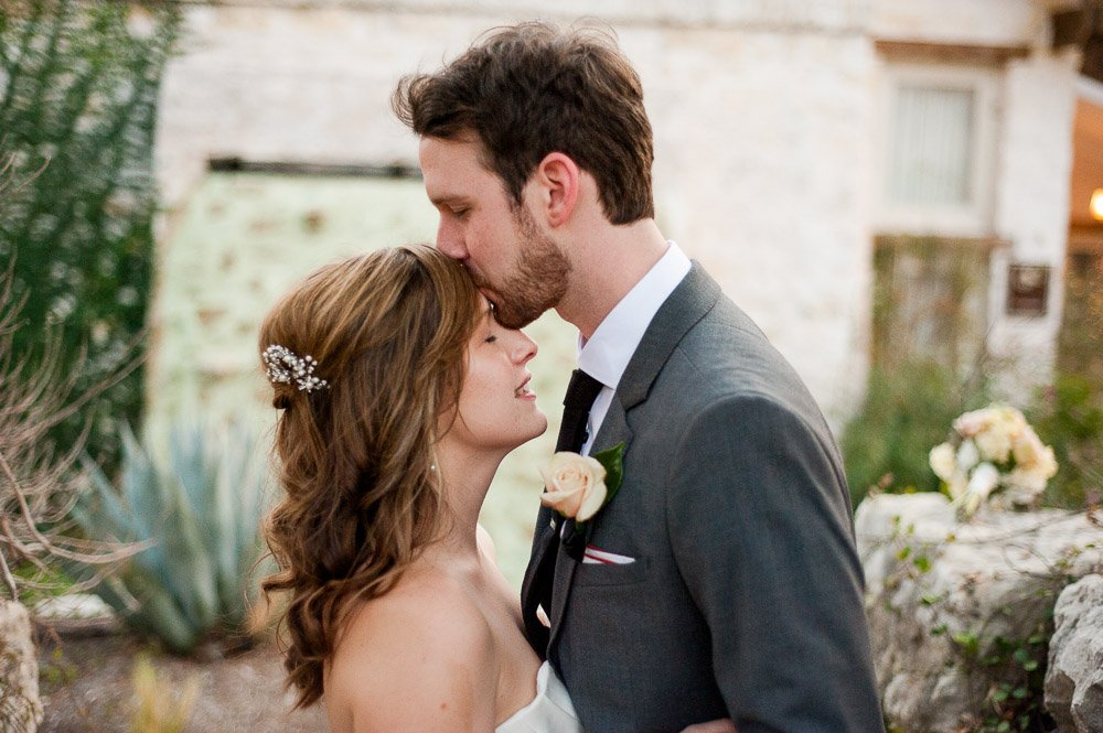 bride and groom portrait forehead kiss