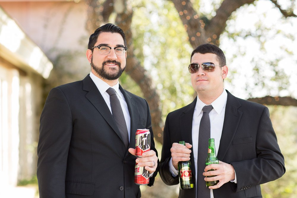 groomsmen in black suits at a vintage inspired wedding in austin texas