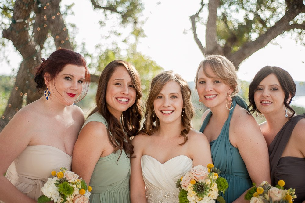 bridesmaids in different styles and colored dresses at a spring wedding in austin texas, natural light portrait photography, DIY photographer,