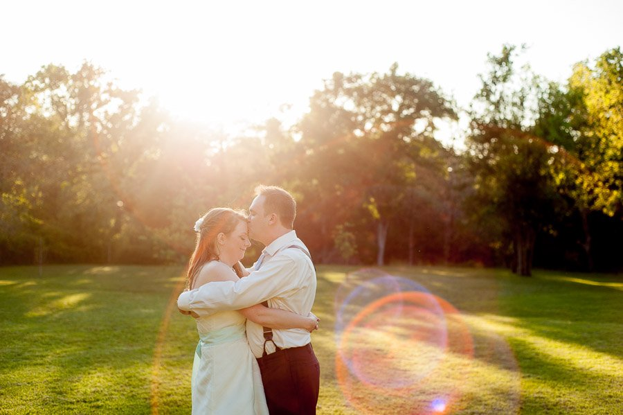 austin wedding photographer backyard weddings, cedar bend events center wedding, backyard wedding, forehead kiss photos, sunflare portraits at weddings, wedding portrait photography, bride and groom austin wedding,