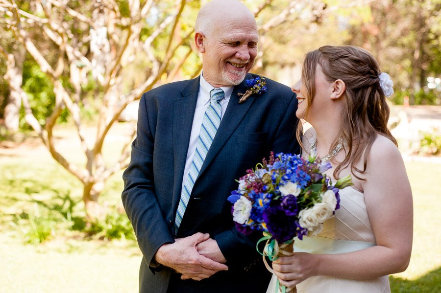 cedar bend events center, dad laughing at daughter before walking down aisle