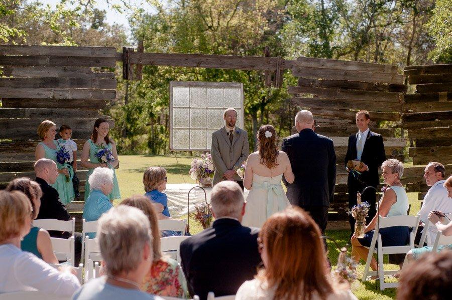 father walks bride down aisle cedar bend events center,