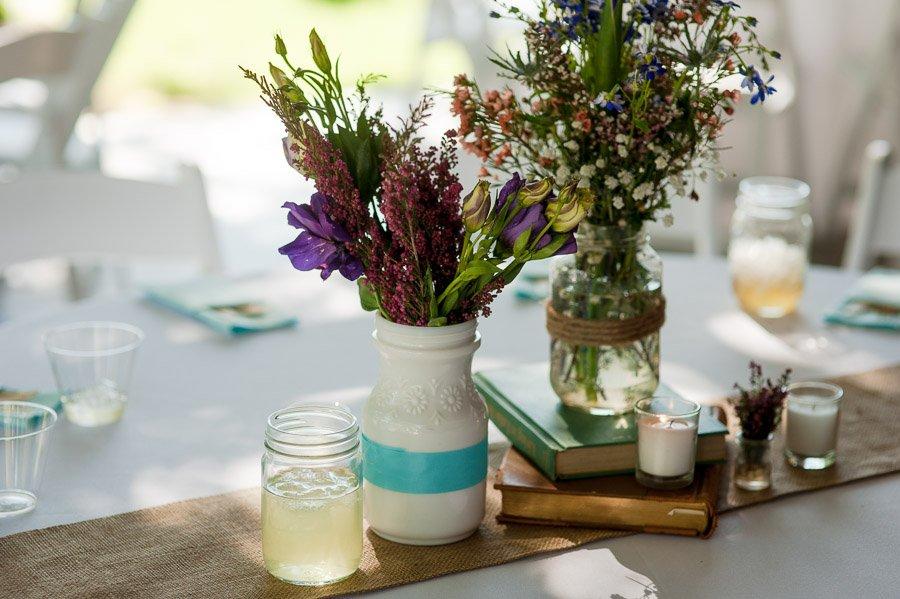 wildflower flower centerpiece, flowers in jars, vintage table decorations, DIY wedding, old book table decorations, book theme wedding decor