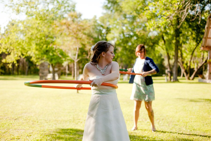 bride hula hooping cedar bend events center, bride hula hoops in wedding dress, wedding reception activities cedar bend events, austin vintage wedding photographer, unique austin wedding photographer