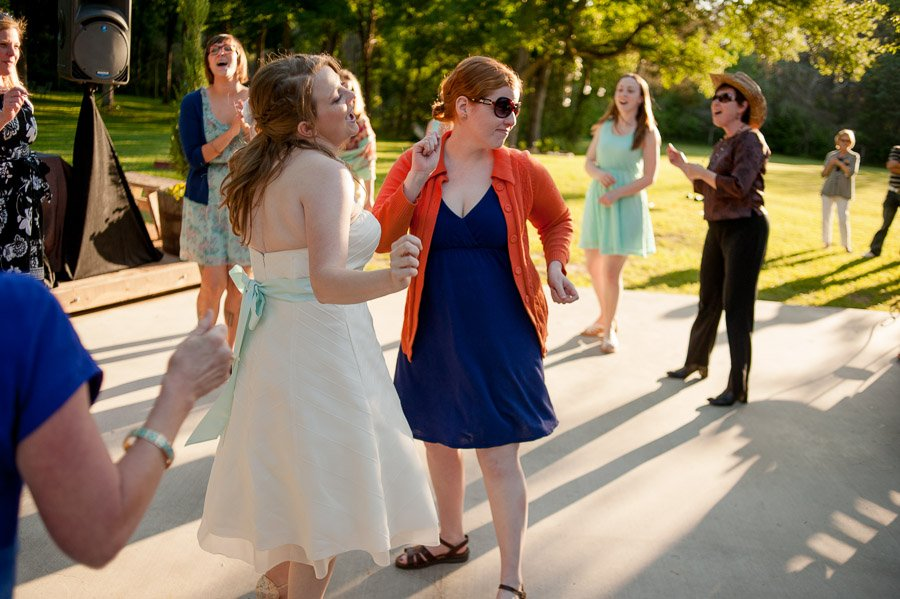 bride and friend dancing during reception