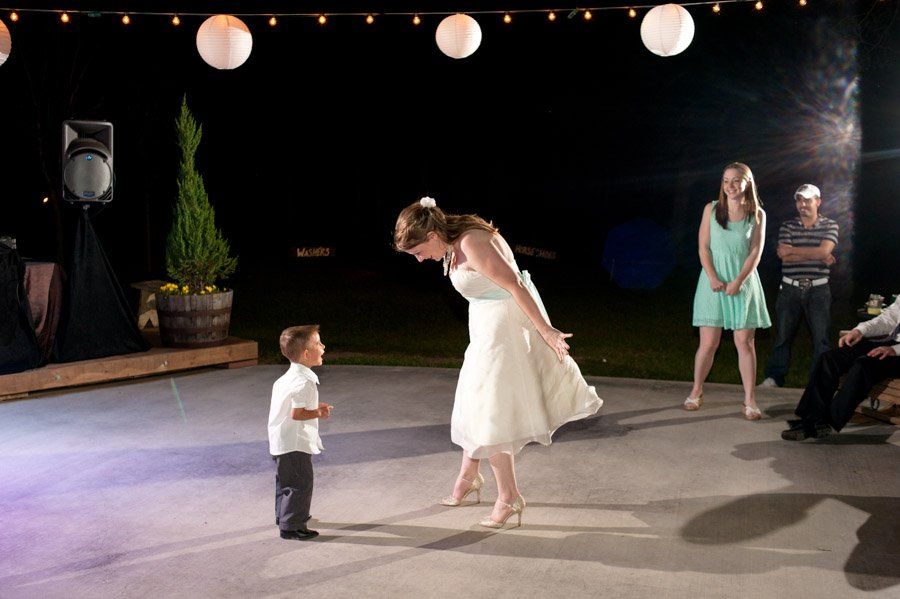 bride dancing with nephew at wedding reception in cedar bend events center austin texas