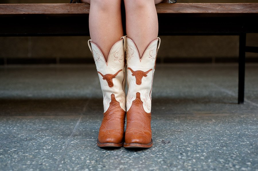 gameday boots in senior pictures, university of texas graduate portraits, graduation photography,
