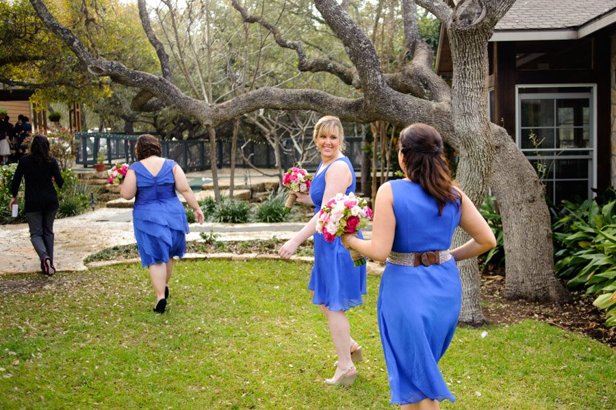 bridesmaids laughing and walking