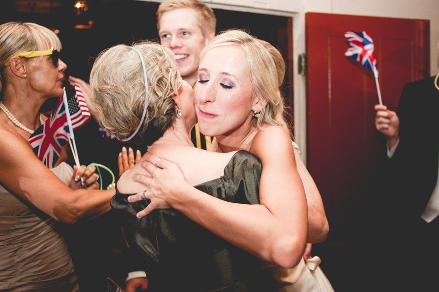 bride hugs her mom at the end of the wedding night as a thank you for the whole event