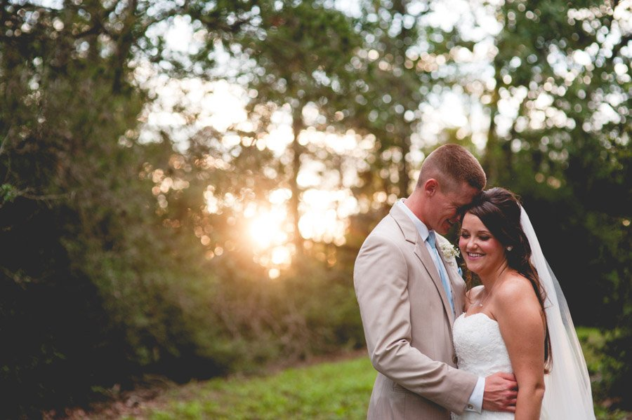 shiner rustic chic sunset portraits, forehead touch, sweet bride and groom portrait moments, bride and groom wedding day portraits