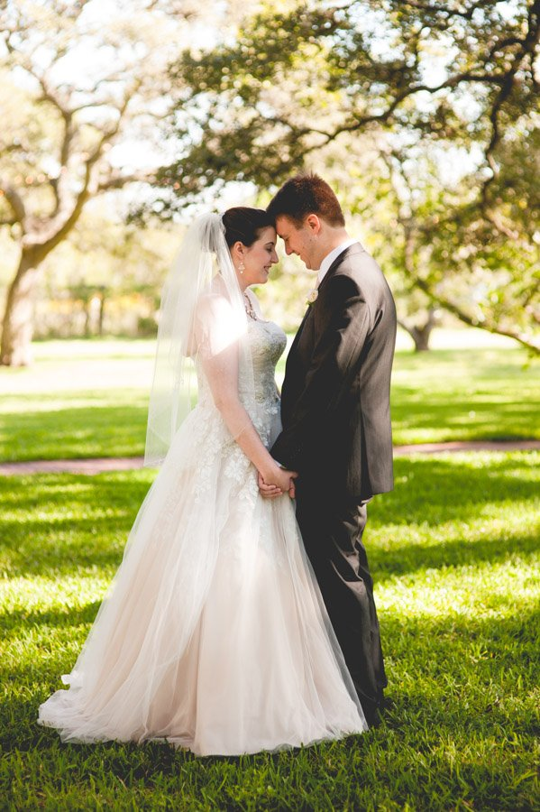 sunny tree bokeh bride and groom portraits at winfield inn