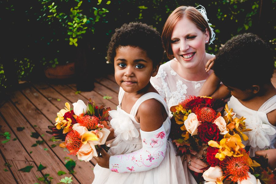 mom and two daughters pose for a portrait after the small wedding ceremony in austin