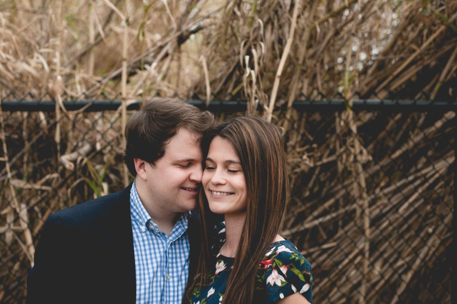 austin couple kissing in front of natural grasses, cute couple smiling next to each other, proposal photography, central texas natural light photography, professional proposal photographer austin texas,