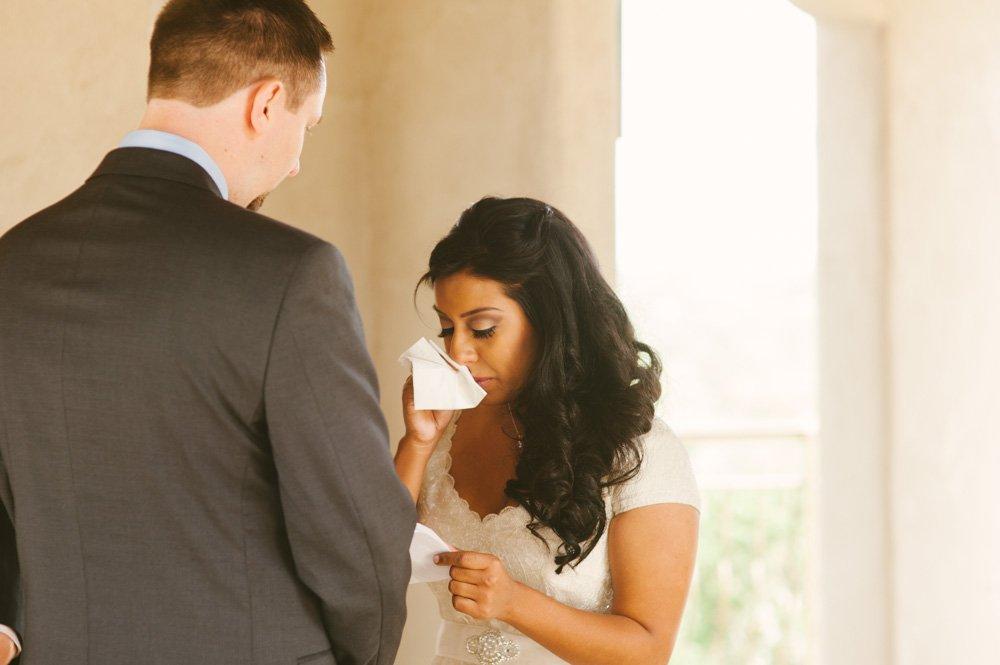 bride wipes away tears during wedding at chapel dulcinea in driftwood