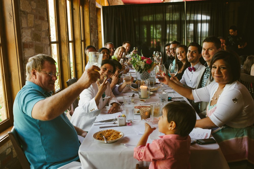 mandolas winery wedding reception, guests toasting each other at intimate restaurant wedding, austin elopement photographer,