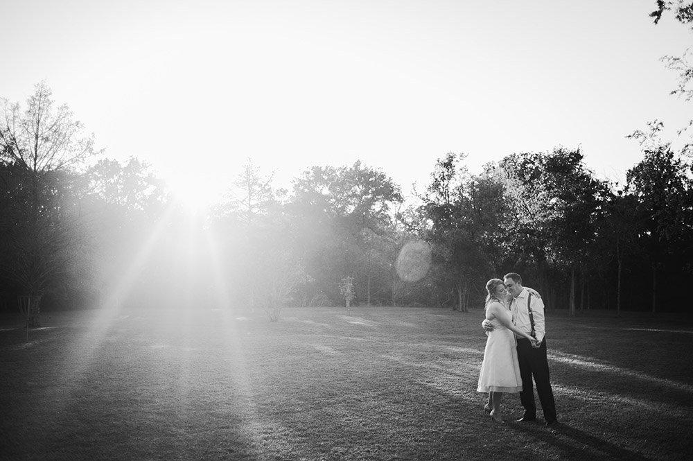 sunset at cedar bend, couple kiss after their wedding