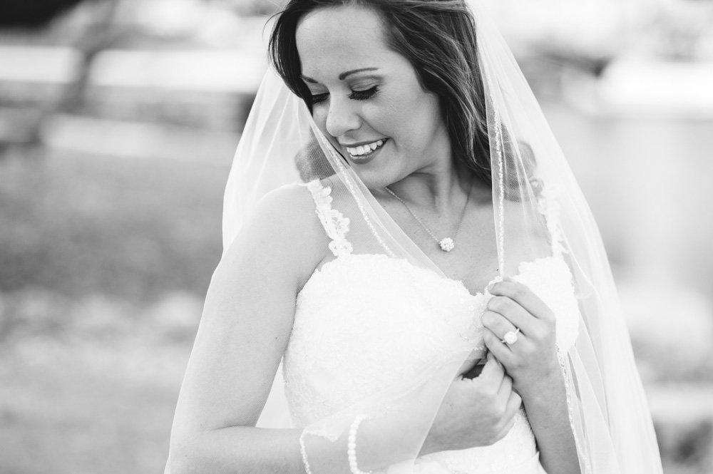 san antonio bridal portraits, black and white bridal shot with bride holding veil, black and white bride, rustic chic bridal san antonio lodge at bridal veil falls, spring bride