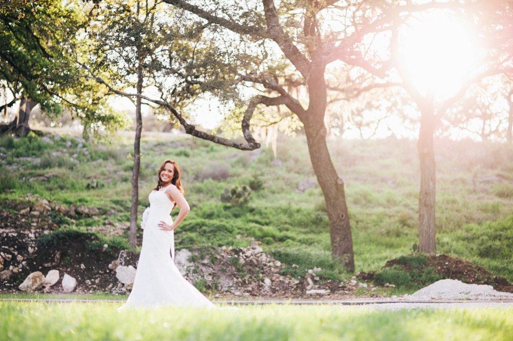 san antonio bridal portraits, bride smiling and looking over shoulder during bridals in spring branch, spring branch bridal portraits, country chic bridals, pre wedding day portrait of bride looking happy