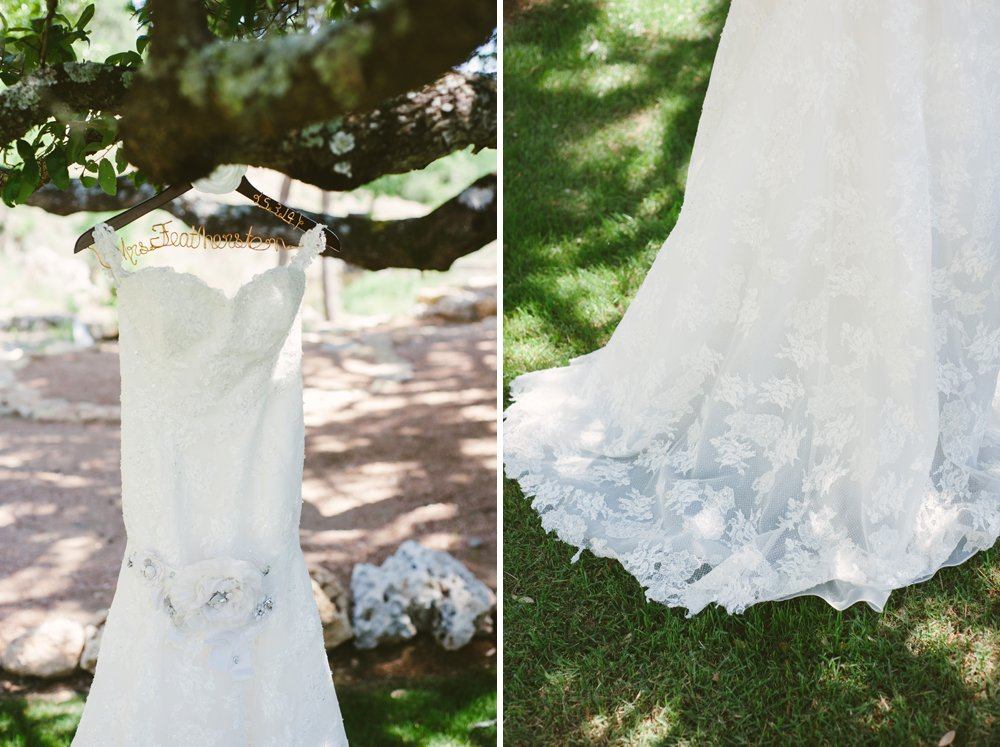 lace wedding dress hanging on custom hanger at hidden falls wedding, dress detail photos