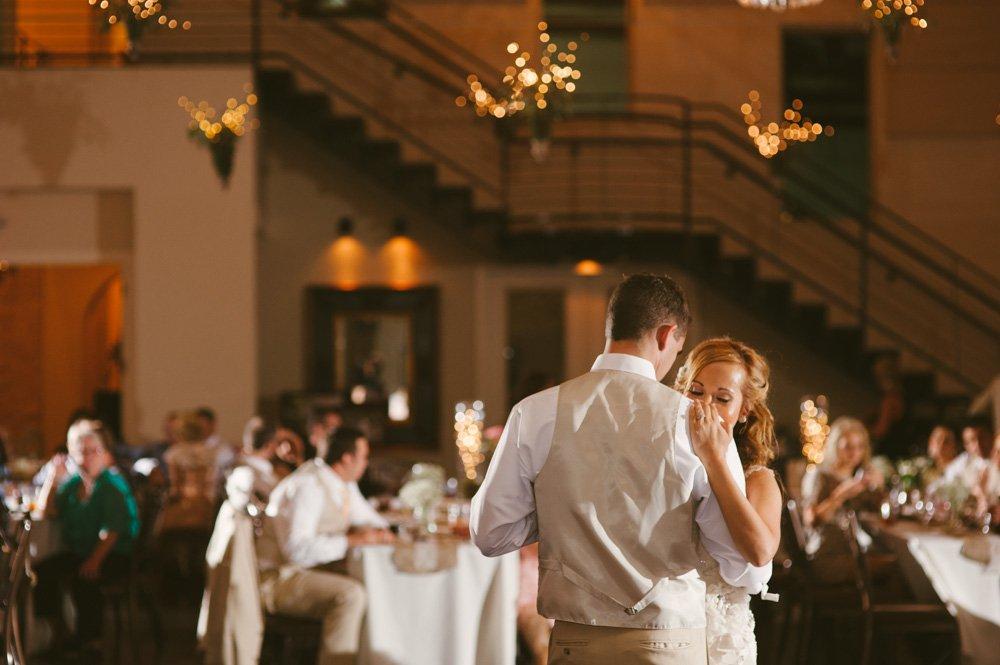 classic first dance wedding, bridal veil falls wedding in san antonio, bride and groom first dance together, romantic dancing wedding photography in spring branch