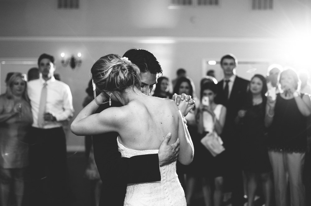 first dance in black and white at lakeway room vintage villas austin, romantic and creative wedding photographer in austin texas, black and white photograph of a couple's first dance, vintage villas wedding photographer