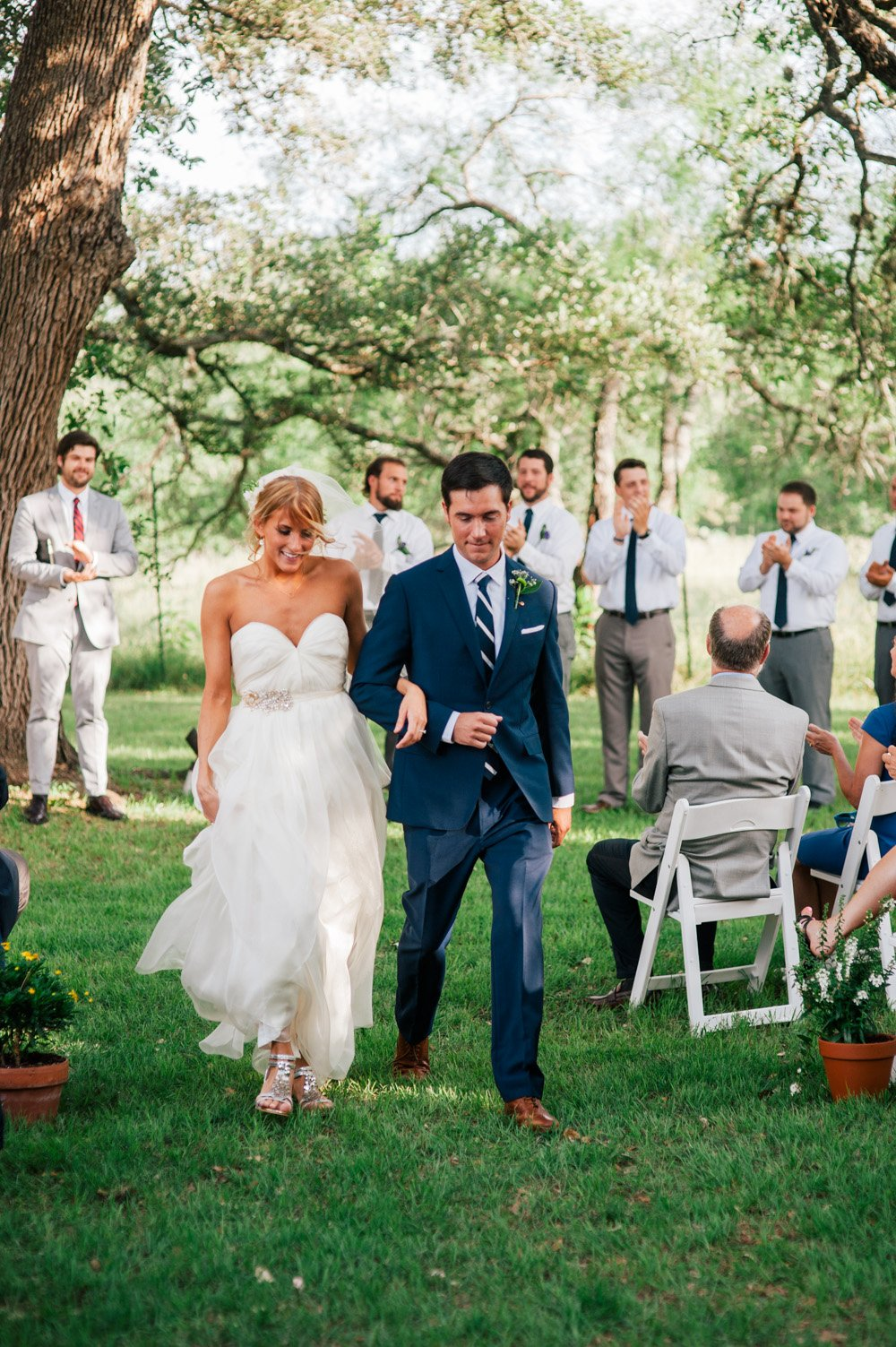 plant at kyle wedding photography, bride in sandals walking back down the aisle after french bohemian chic wedding