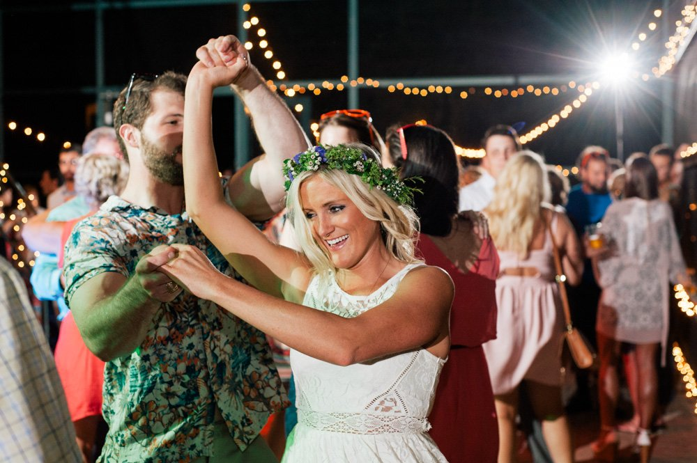 reception photos at the plant at kyle, flower crown bride and fairy lights at an outdoor austin reception
