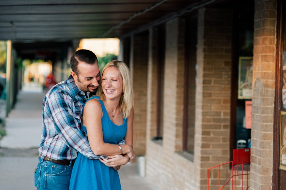 summer engagement session in buda texas, natural engagement photos in texas, cute engagement session ideas in austin, austin engagement photographer, creative natural light wedding photographer in austin, color photos of downtown buda, buda engagements