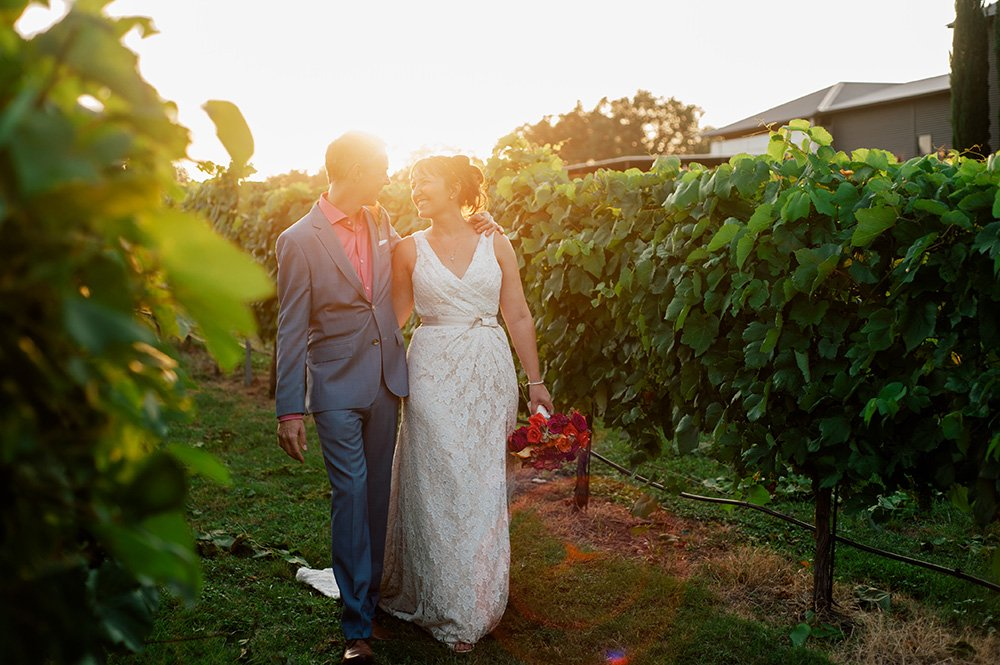 sunset portraits at austin vineyard, vineyard weddings in the fall, texas winery wedding, intimate austin wedding at stone house vineyard, sunset couples portraits in vineyard
