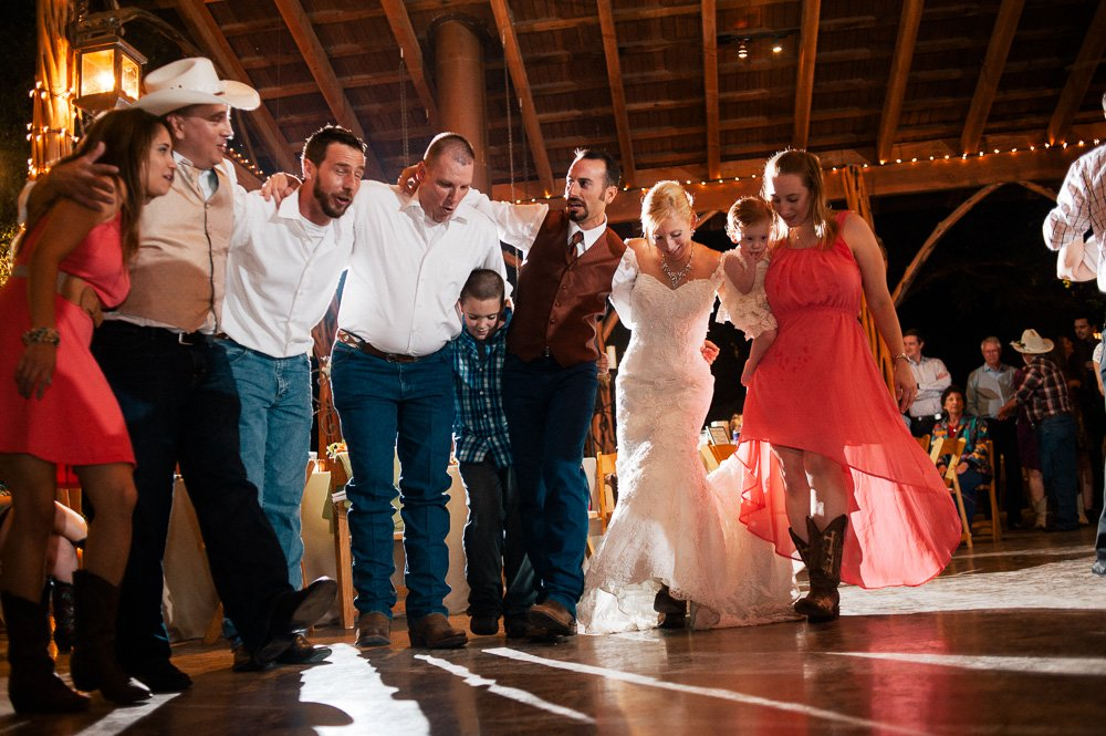 guests laughing and singing during reception at ranch in austin, central texas wedding photographer under 3k, creative wedding photographs for modern couples in austin, emotional reception photography austin texas,