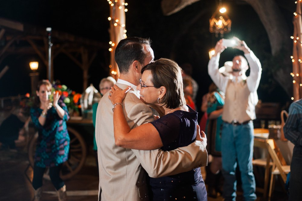 mother and son dance at a rustic wimberly wedding