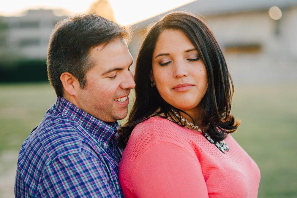 alex stivers engagement photographer, romantic couple pose during engagement sessions, pink and blue couples portraits,