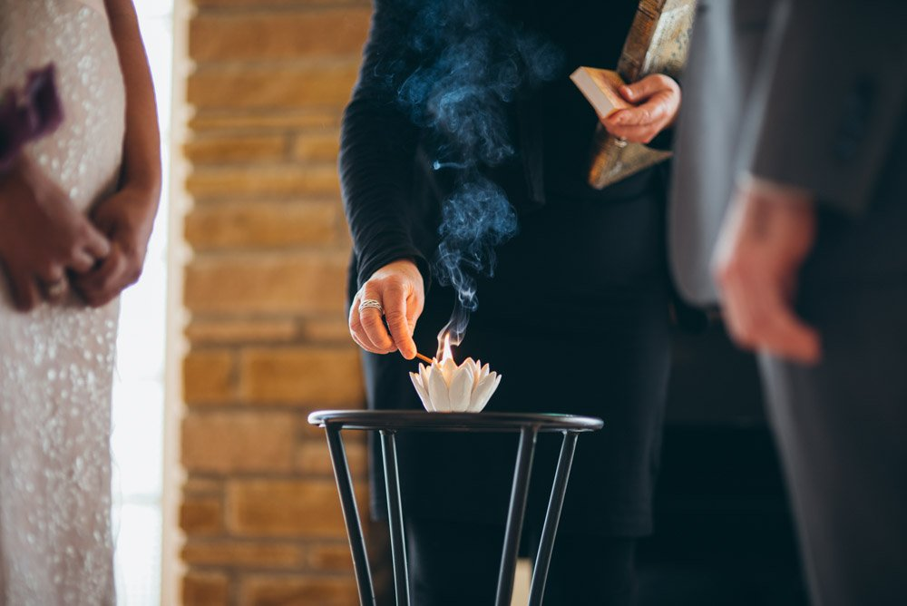 lotus candle lighting during intimate wedding ceremony at home in austin texas