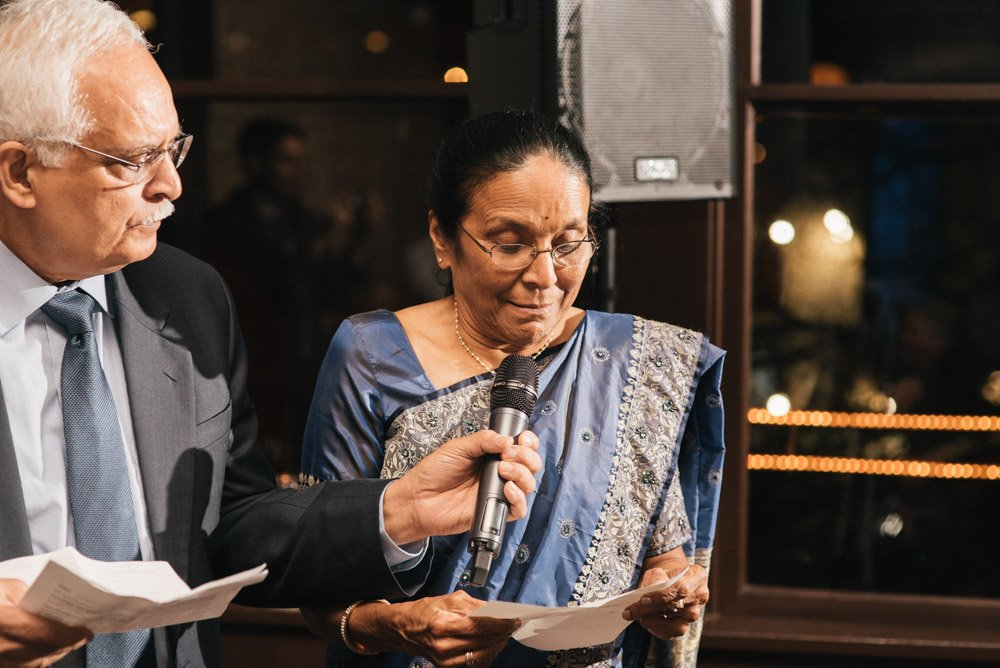 mother of the bride toast at parkside, hindu wedding reception, hindu american intimate wedding downtown austin, bride's mother reading prayer from grandmother aayi