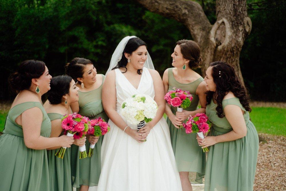 bridesmaids laughing, pink and green wedding at mercury hall, green high low bridesmaids dresses, pink bridesmaids bouquets