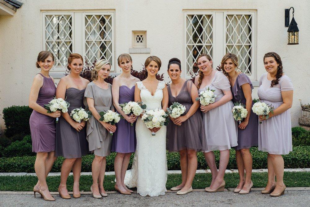 laguna gloria wedding photographer, bridesmaids with bride in front of laguna gloria, spring wedding in austin