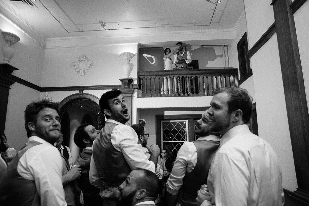 groomsmen react to garter toss at laguna gloria