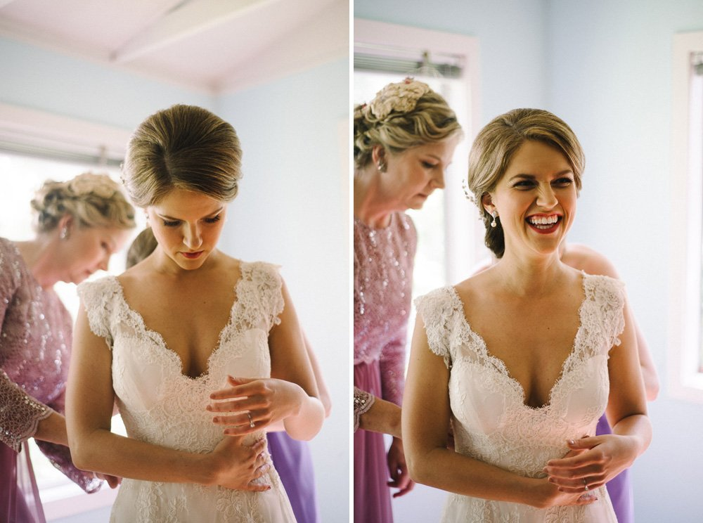 bride laughs while getting dressed at her laguna gloria wedding