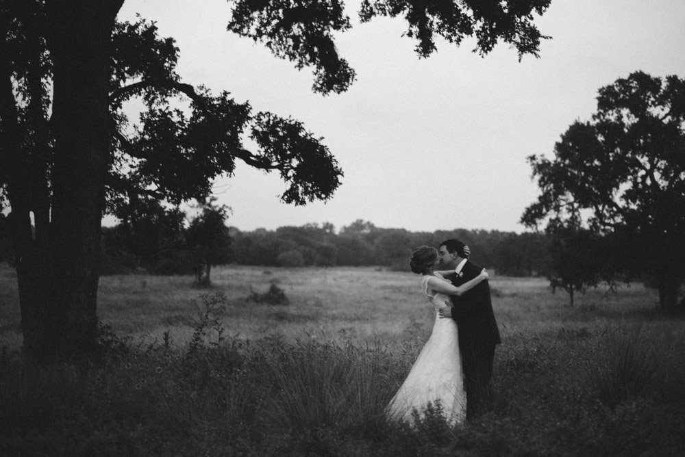 black and white wedding photos in a field