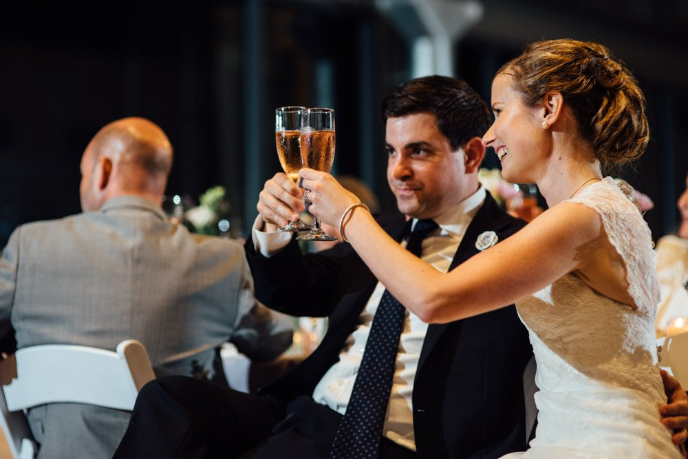bride and groom toasting champagne during their wedding at the lady bird johnson wildflower center in austin texas