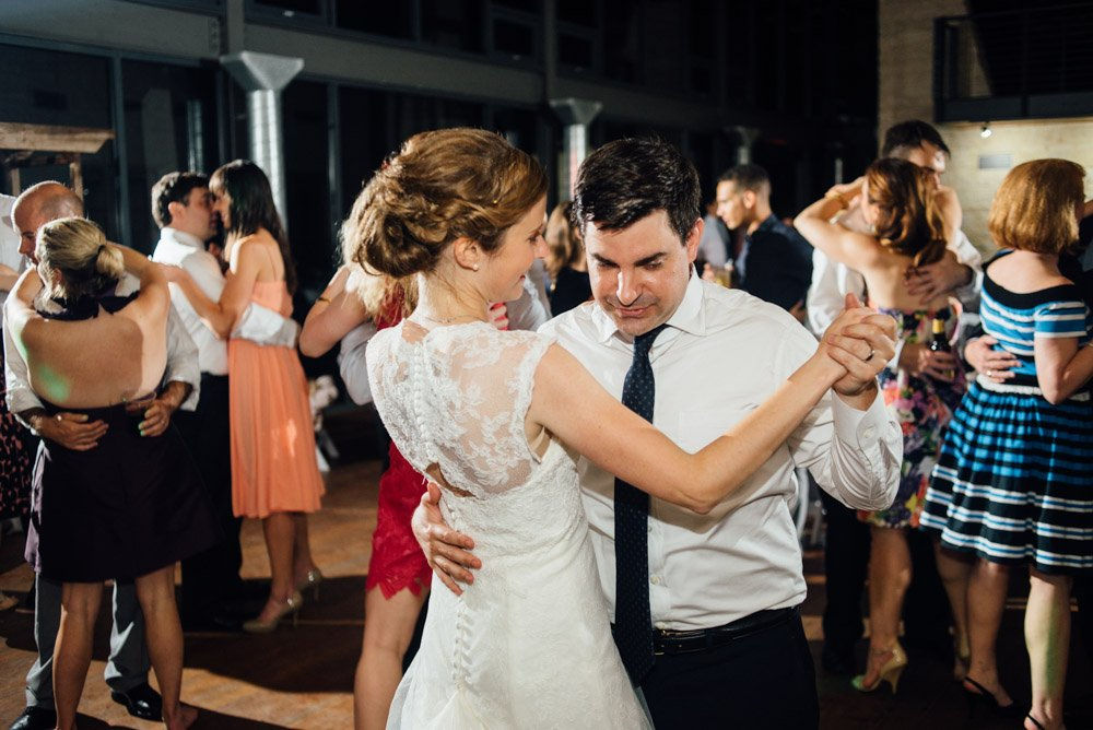 bride and groom dance during their wedding reception